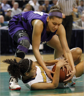 Div. 1 state final: Andover 61, Holyoke 45 Andover's Angelice Gonzalez battled with Holyoke's Alison Littles in the first half. Andover capped a perfect season (27-0) with its third straight state championship.