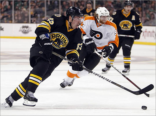 Brad Marchand made a break for the net in front of the Flyers' Jakub Voracek during the second period.