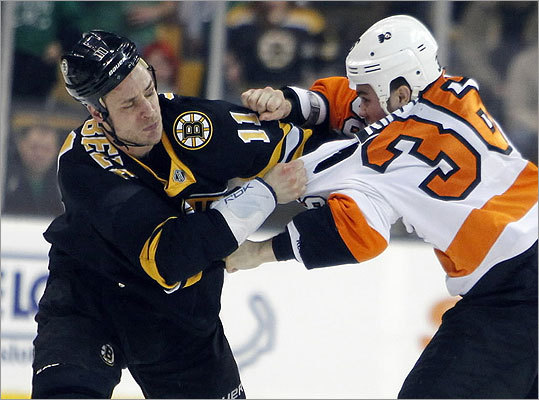 Gregory Campbell of the Bruins and the Flyers' Zac Rinaldo threw punches early in the game.