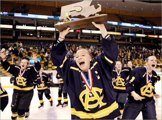 Arlington Catholic captain Rebecca Zappala led her team around the ice with the state championship trophy after defeating St. Mary's, 3-1, in a Division 1 state final hockey game at TD Garden on Sunday, March 18.