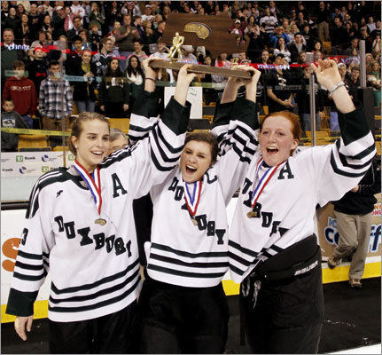 Duxbury captain Martha Findlay (center) and assistant captains Lily Connolly (left) and Hannah Murphy held up the championship trophy after defeating Falmouth, 3-1, in the girls' Div. 2 state final.