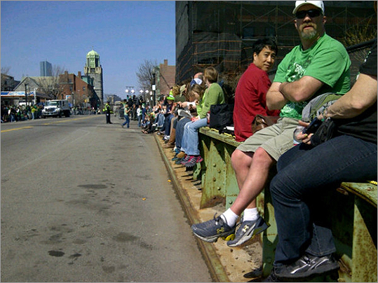 The West Broadway bridge filled up with parade spectators who wanted a seat.