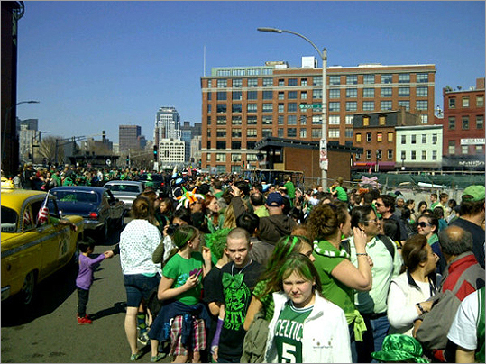 Crowds mingled among cars in South Boston.