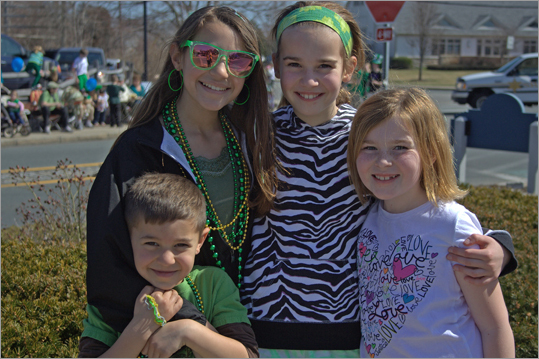 (From left) E.J.Guarachi, 5 1/2, Sarah Guarachi, 10, Lilly Clifford, 10, and Sofia Clifford, 9, all from Norwell, were enjoying the nice weather as well as the parade.