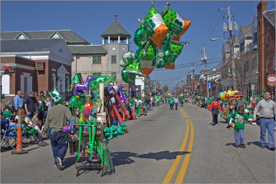 Vendors selling everything from balloons to cotton candy strolled down Scituate's Front Street, the main road for the parade. By the end of the festivities, most were just pushing empty carts.