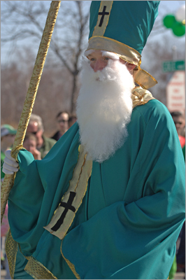 Dressed as St. Patrick, students from St. Brigid walk the streets of the parade.
