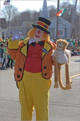 Clowns entertain the crowd.
