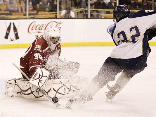 Malden Catholic's Ara Nazarian was stopped by BC High goaltender Peter Cronin.
