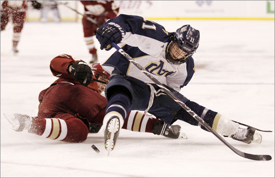Malden Catholic's Tyler Sifferlen battled for a loose puck with BC High's PJ Johnson.