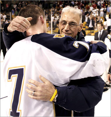 Malden Catholic captain Brendan Collier hugged coach Chris Serino after the game. Serino has been battling throat cancer and was unable to coach the team from the bench all season.