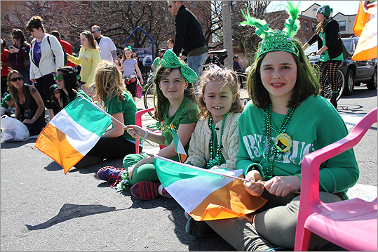 Sarah Rose Doherty, left, 9, Coleen Golden, 7, and Nina Dunn, 11, each from Lynnfield watched the parade. Doherty said she has attended every South Boston parade since she was a baby.