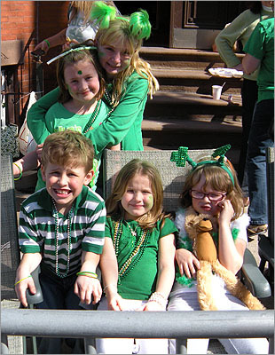Thomas Taylor, 7, Nicole Taylor, 6, Lily Welch, 6, Morgan Welch, 7, and Kristina Quigg, 10, gathered on G Street to watch the day's festivities.