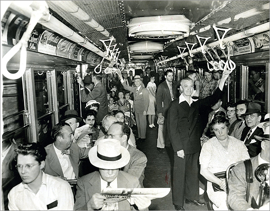 The Cambridge subway was owned privately by the Boston Elevated Railway. However, the line cost $12 million to build and the company struggled with the debt until the state had to step in to prevent it from going bankrupt in 1918. The state bought the Cambridge Tunnel from the Boston El in 1920 and eventually bought the company outright in 1947. The company was transformed into the Metropolitan Transit Authority that year and in 1964 it became known as the Massachusetts Bay Transportation Authority. The interior of the remodeled MTA tunnel train is pictured between Harvard and Central Squares on its first trip in 1948. It featured upholstered chairs, fluorescent lights, and polka-dot curtains.