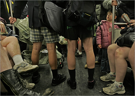 Five-year old Emily Nye is pictured looking up in bewilderment as she and her parents, tourists from England, are surrounded by people wearing no pants while riding the in-bound Red Line The No Pants Subway ride started in New York City and has been an annual tradition in Boston since 2007.