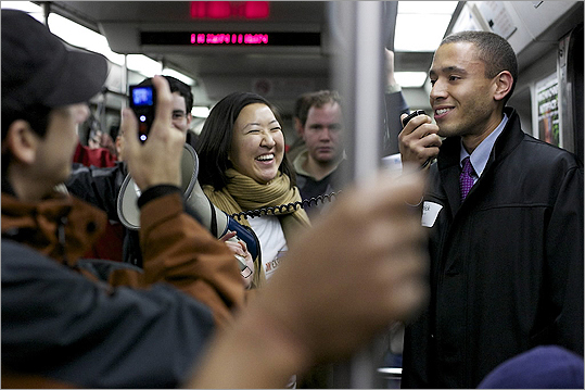 The 'Innovation Express' recently held an event on a Red Line train to promote networking for entrepreneurs. The event was sponsored by Boston World Partnerships, a nonprofit created by Mayor Thomas M. Menino to raise global awareness of Boston as a center of intellectual capital and innovation. From left, Yoon Lee laughs while Nick Martin of the mayor's office addresses the attendees.
