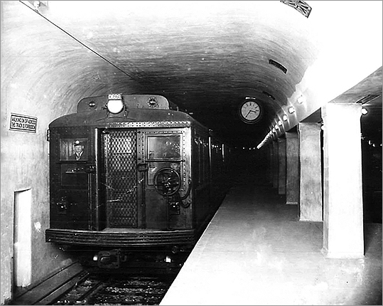 The trains left Harvard Square with Mrs. Collett and 285 other riders at 5:24 a.m. and picked up 20 additional riders at Central and Kendall stations, according to historian Bradley H. Clarke. The passengers arrived one minute ahead of the eight-minute advertised schedule at Park Street Under-- which was what people called the tunnel beneath the Green Line at Park Street Station back then. The train at Harvard Square Station is pictured on March 20, 1912, before the station officially opened.