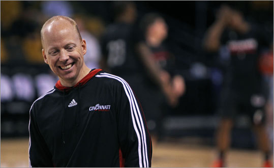 Cincinnati coach Mick Cronin was interviewed for television while his team practiced on Wednesday.