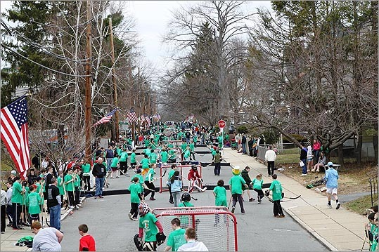 Surrounded by throngs of cheering parents, grandparents, and siblings, a record 500 children converged on a quarter-mile stretch of a closed-off, holiday-decorated street on St. Patrick's Day to play in an annual neighborhood street hockey tournament. Five years after its inception, the Shamrock Shootout has mushroomed into a beloved March 17 tradition for many West Roxbury families and that large turnout in the Boston neighborhood known for its high voter turnout has drawn support, appearances and some participation from local politicians.