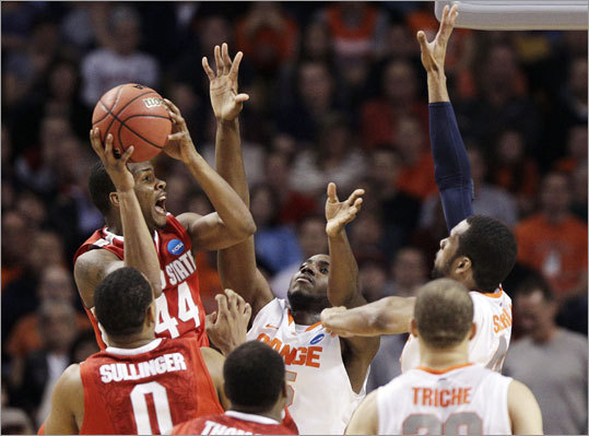 Ohio State's William Buford gave it his best shot against Syracuse's Rakeem Christmas (center) and James Southerland (right) in the second half of the NCAA East Regional final at TD Garden. Ohio State defeated Syracuse 77-70 to advance to the Final Four.