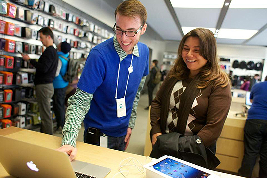 Joe Pratolongo helped Ana Celidonio's set up her first iPad at the Apple Store on Boylston Street.
