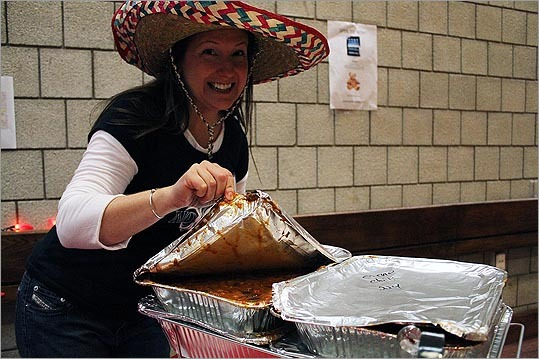 While the Dorchester Day Parade may not be till June, residents were busy Sunday at the Dorchester Chili Cook-off to raise money for the parade. Over 22 restaurants and neighborhood associations took part in the event held at the IBEW Hall. To the left, Susan Capachione of the Eastman Elder Neighborhood Association, showed off her group's offerings, donated by 224 Boston Street.