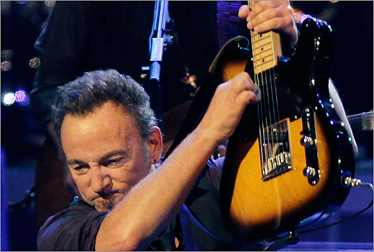 Bruce Springsteen was superhuman Monday night, running, sliding and crowd-surfing.