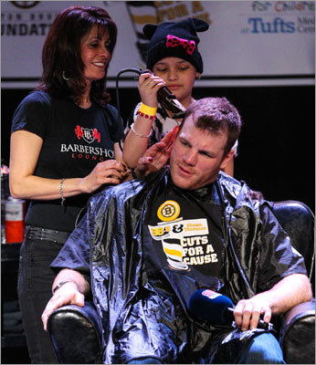 Bruins tough guy Shawn Thornton had his head shaved by Anna Reece (top, right) at Royale, located on Tremont St. in Boston. Fans could purchase tickets to the event and also had the chance to bid on cutting a player's hair.