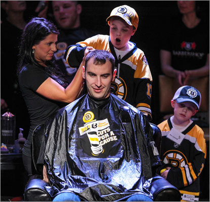 A child helped a hair stylist cut Bruins captain Zdeno Chara's hair. The event raised more than $58,000 for the Floating Hospital for Children at Tufts Medical Center.