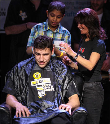 Milan Lucic had his haircut done by Shahil Patel (top, left). Stylists from the Barbershop Lounge in Boston assisted with the haircuts.