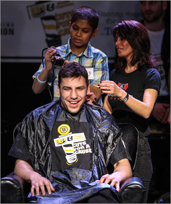 Milan Lucic smiled as fans watched his hair being progressively cut.