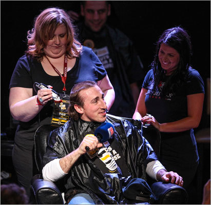 Brad Marchand addressed the crowd as Kimberly Wallbank took off his hair from the top first, creating a temporary hairdo for the moment.