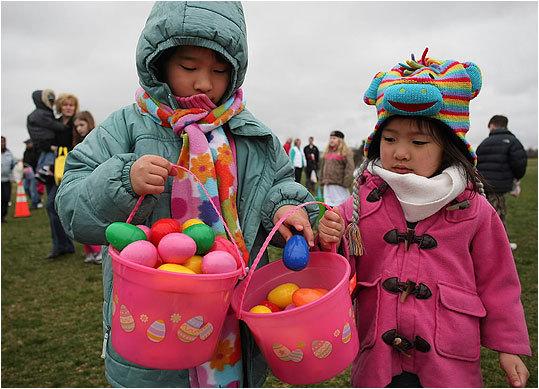 Valerie Chung (left), 7, gave an egg to her sister, Chloe, 4.