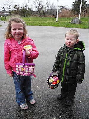 Orla (left), 4, and Killian, 2, of Dorchester, used their baskets to carry eggs and popcorn.