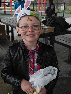 Ruairi, 6, of Milton, went to the event with bunny whiskers painted on his face.
