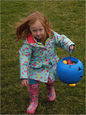 Beatrix, 3, of Milton, ran around the park to pick up eggs.