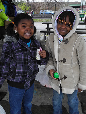 Jorden (left), 7, of Fitchburg, and Jamyah, 6, of Boston, paused for a picture before opening their remaining eggs.