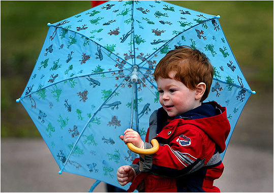 Kevin, 2, of Quincy, brought an umbrella for the light rain and drizzle.