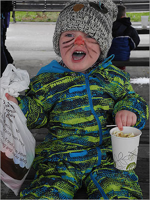 Shay, 2, of Milton, enjoyed a cup of popcorn after the hunt.