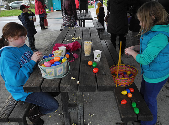 Sophie, 10, and Kate, 9, of Dorchester, counted and opened the plastic eggs after the hunt.