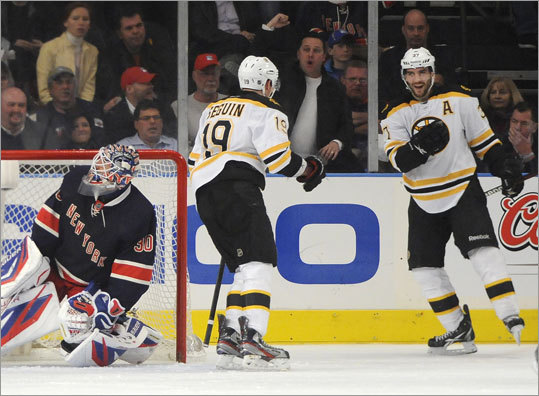 Center Patrice Bergeron (right) gave the Bruins a 2-1 lead in the second period when he beat Rangers goalie Henrik Lundqvist with a wrist shot off an assist from Tyler Seguin (left).