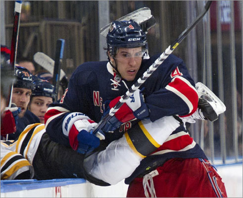 Rangers defenseman Michael Del Zotto checked Bruins right wing Rich Peverley into the Rangers bench in the second period.