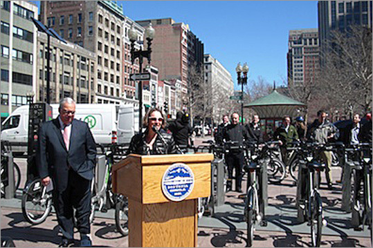 "Boston Bikes director Nicole Freedman welcomes bicyclists at the event before announcing she is stepping down from her post on April 20 to take a job in Maine. Freedman, who is widely credited with bringing 50 miles of bike lanes to Boston under her tenure, says she expects Boston to continue to pursue its biking initiatives. 'The mayor has been a dedicated leader to the issue and it will continue to be a great success,"" she said. The city is currently raising money to add stations to more Boston neighborhoods including, Dorchester, Charlestown, Jamaica Plain, and Roxbury."
