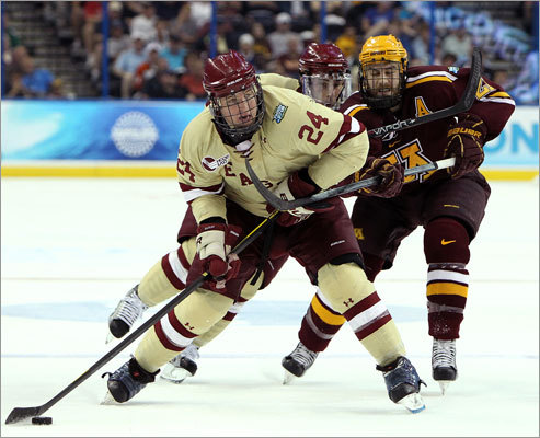 Boston College forward Bill Arnold stepped into a shot as he was checked from behind by Minnesota's Jake Hansen during the first period.