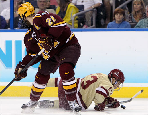 Boston College's Johnny Gaudreau was forced to play the puck while down on his knees during the first period.