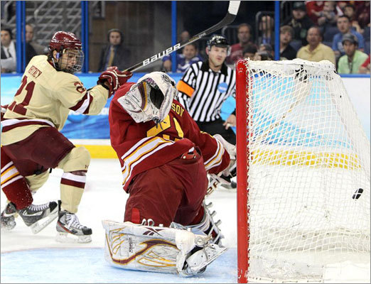 Boston College's Steven Whitney (21) snaped a shot past Ferris State Bulldogs goaltender Taylor Nelson (29) for the first goal of the game in the first period of the men's Frozen Four National Championship at the Tampa Bay Times Forum.