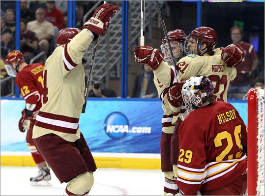 Boston College's Steven Whitney (21) and teammates celebrated after Whitney scored to give the Eagles a 1-0 lead in the first period.