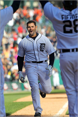 Tigers catcher Alex Avila was congratulated by his teammates at home plate after Avila's home run gave the Tigers a three-game sweep of the Red Sox in the season-opening series for both teams.