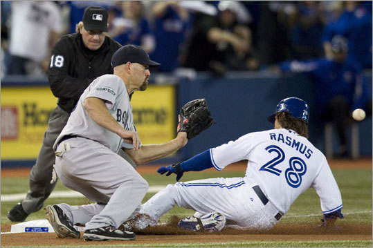 The Blue Jays' Colby Rasmus beat the throw to third baseman Kevin Youkilis in the third inning. Rasmus scored on a fielder's choice.