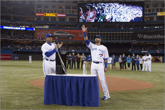 Blue Jays outfielder Jose Bautista (right) was presented with his 2011 Silver Slugger Award by hitting coach Dwayne Murphy before the Blue Jays' home-opener.