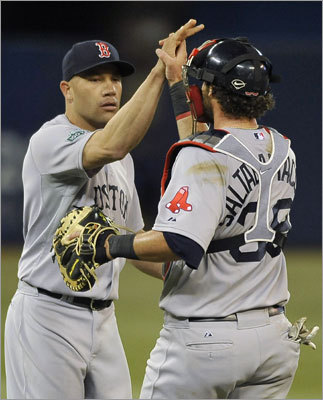 After three straight losses to open the season, Alfredo Aceves (left), Jarrod Saltalamacchia and the Red Sox finally picked up their first win of the season, a 4-2 victory over the Blue Jays in the opening game of a series at Rogers Centre in Toronto. Aceves earned a save.